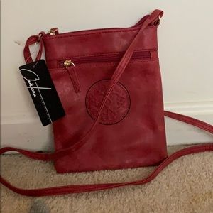 Distressed light red crossbody bag